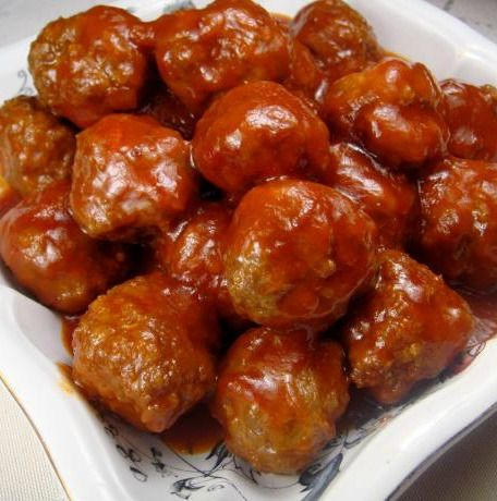 Sweet and Sour Meatballs - A lighter take on this party and tailgating favorite in your slow-cooker. You will blow them away with how good this easy, and only you need to know how easy it was.