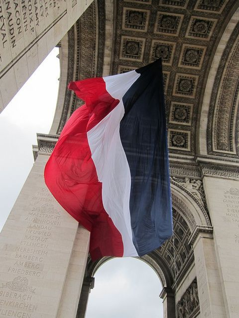 """Le tricolour.  Paris France.  """"The Arc de Triomphe was the centre of the major event today, of course"""", taken on May 8, 2012.  VE Day, Armistice 1945, by Stephen Rees."""