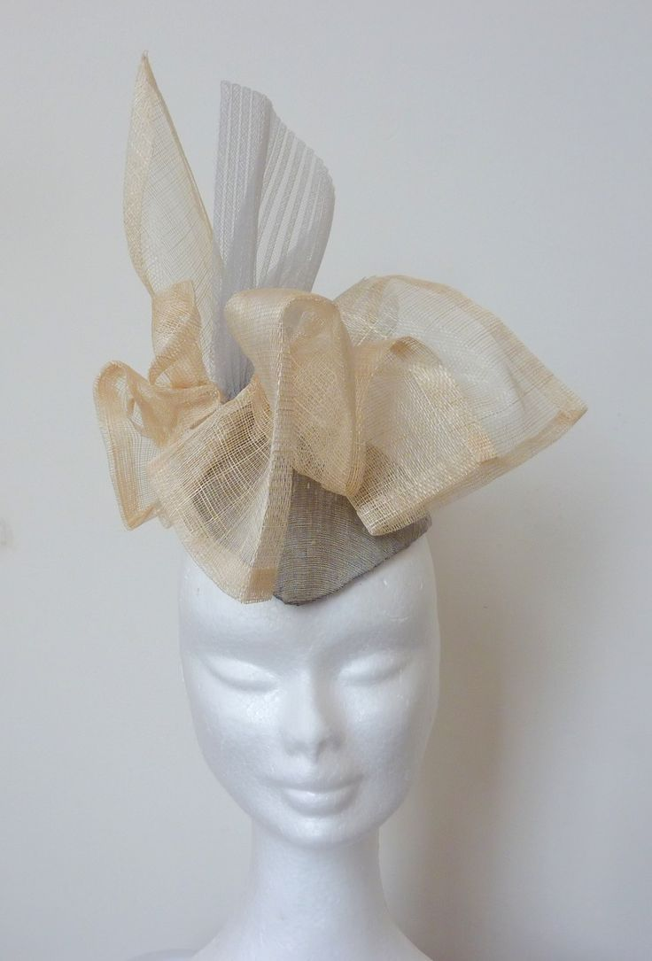 Race hat/ cokctail hat silver cream Silver-grey hand-blocked silk base. Cream sinamay with a weave of pale grey crin.