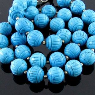10.5mm - AA Turquoise Carved Round Bead Strands