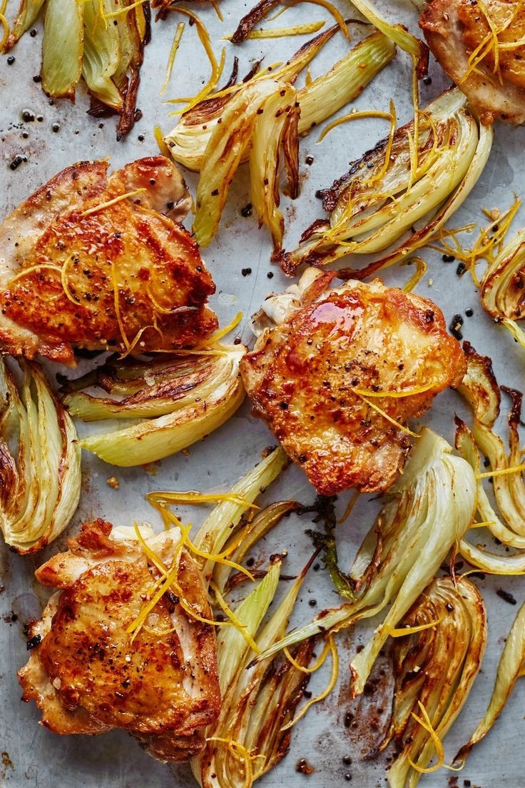 Easy Sheet Pan Oven Roasted Chicken Thighs with Fennel and Lemon Recipe. Looking for ideas for one pan meals and dinners? Try this simple one. You need bone-in skin on chicken thighs, fennel bulbs, garlic, lemon white wine, and rice or bread for serving! Perfect for weeknights or a Sunday supper!