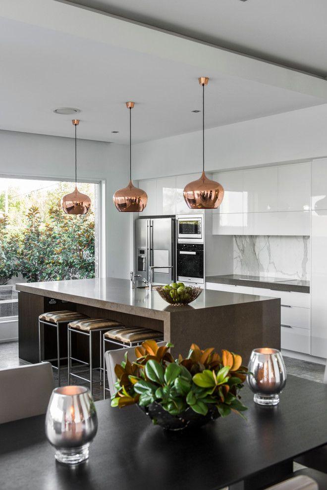 Kitchen with copper pendants, large island, marble backsplash, white cabinets   Highgate House