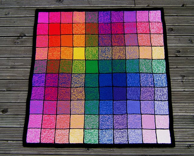 This uses 10 different colors of yarn, all interwoven in different ways.  I think it's beautiful!