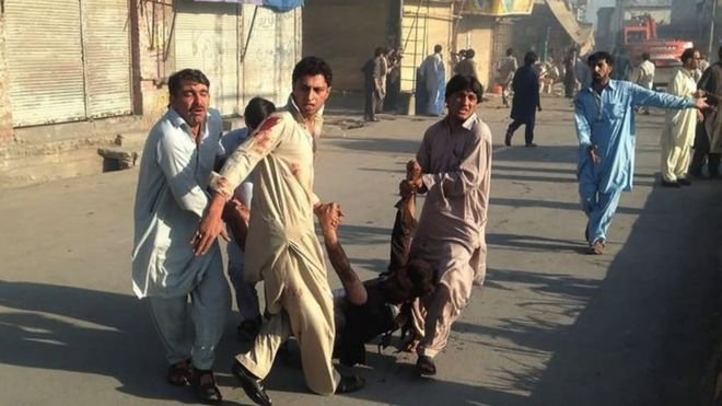 Pakistan day of violence: Scores killed and injured
