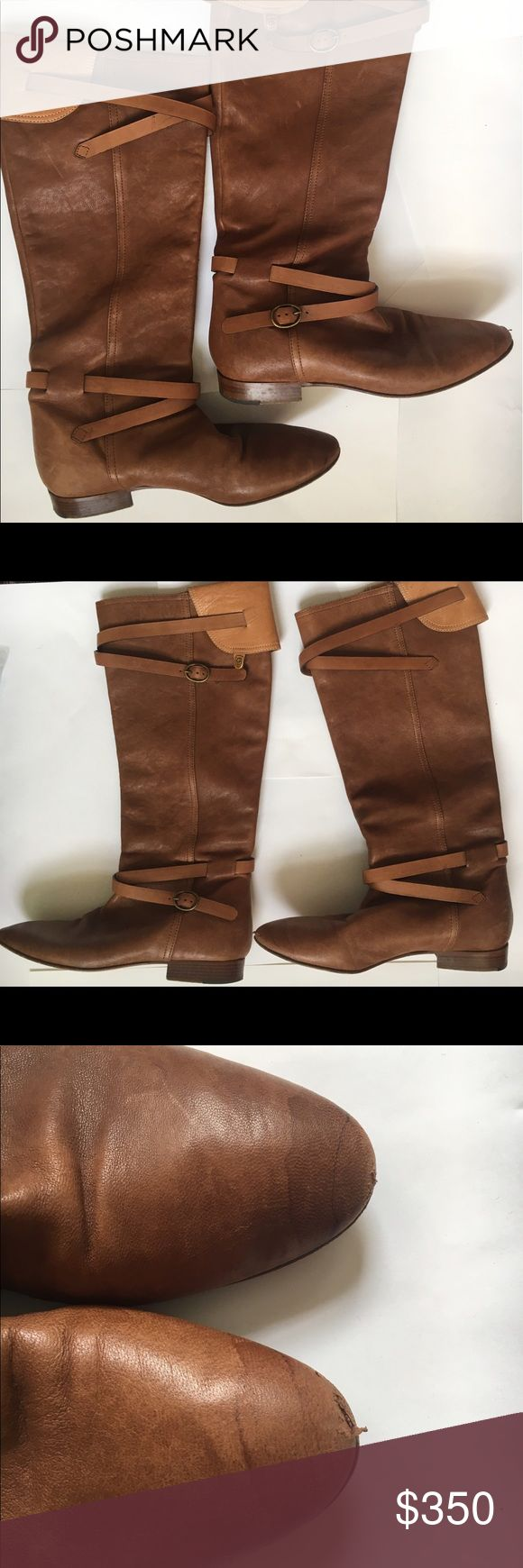 Chloe Brown Strap Buckle Knee High Boots Thee have been worn quite a bit. Leather is very soft, pull on design. Mild scratching and scuffing throughout (see photo). Normal wear and tear for pre-owned boots worn around NYC. Please see photo of toes - slight water mark and nicks at toes. DOES NOT INCLUDE ORIGINAL PACKAGING. Chloe Shoes