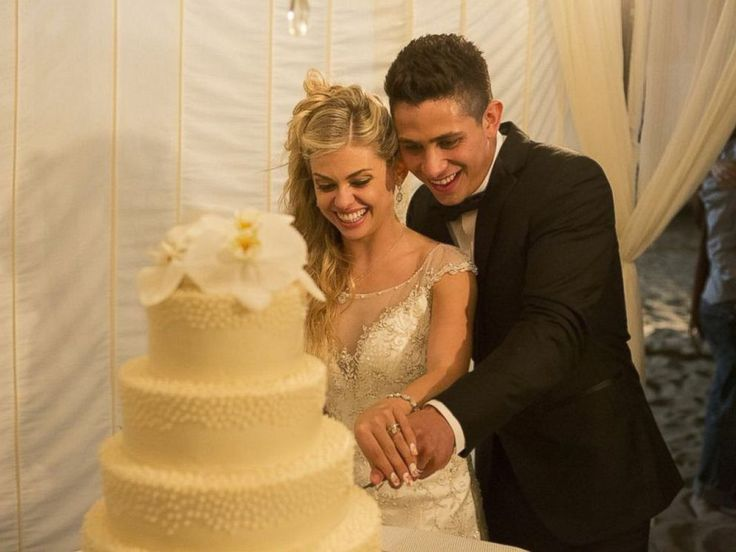 PHOTO: The married couple cut the cake together.