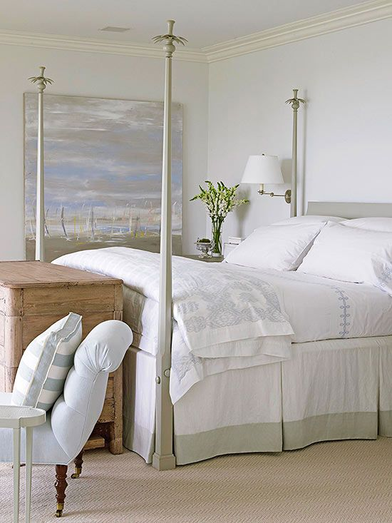 Beach Serenity Gather decorating inspiration from a piece of art or a collection of favorite items. In this bedroom, white-painted walls get a boost of style thanks to a large, statement-making painting. Soft grays found in the painting are echoed throughout the room on the bed frame and bedding. A large wooden chest at the foot of the bed recalls the look of beach wood and lends unique texture.