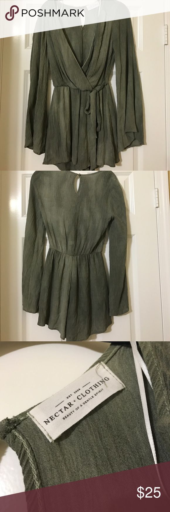 """NWOT 🌴 GREEN LONG SLEEVE ROMPER NEVER WORN but tags are removed! Size is unknown but I am usually very petite and it's a bit looser on me so I assume it's a S/M. From boutique """"Nectar"""" with only a few locations in southern California. listed as free people bc they are v similar! Sleeves flare out at ends. Cut in middle is pretty low but can either be worn open with a bralette or saftey pinned closed. The top left is becoming ripped (as pictured) which is why they sold it to me at a 10%…"""