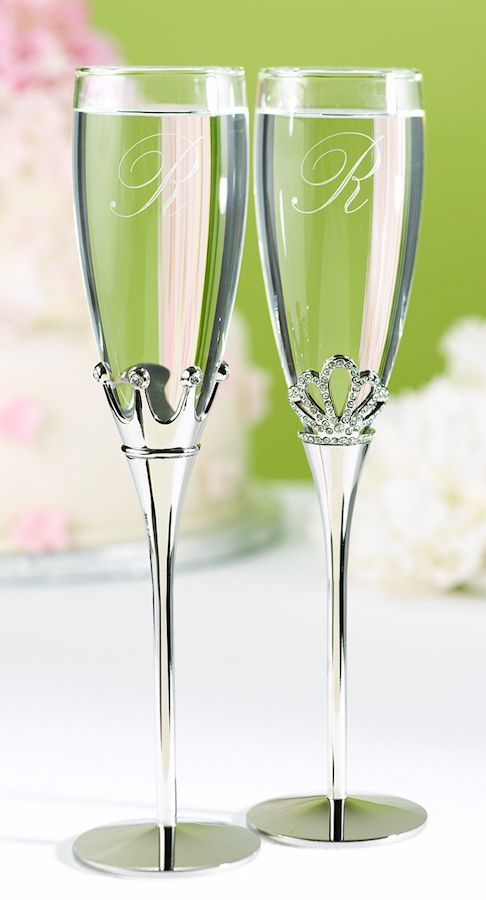 "Nickel-plated stems adorn these wedding champagne flutes decorated with rhinestone studded crowns fit for a King and a Queen. 10 1/4"" tall. Set of two."