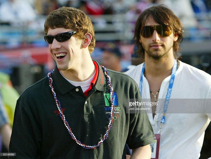 Olympic gold medal swimmers Michael Phelps of the USA and Ian Thorpe of Australia stand on the sidelines before the start of Super Bowl XXXIX between the New England Patriots and the Philadelphia Eagles at Alltel Stadium on February 6, 2005 in Jacksonville, Florida.