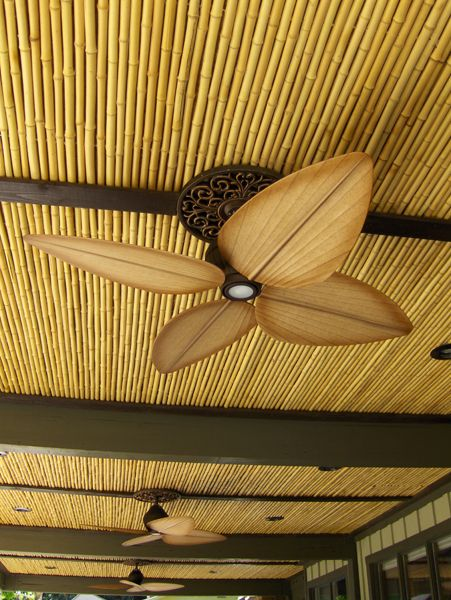 Natural Cali Bamboo fencing as ceiling application for that British Colonial feel.