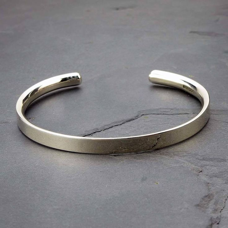 """A lovely solid silver man's bracelet, a perfect gift for men made by silversmiths in our workshop.We can engrave the inside or the outside with a message to personalise it. For an even better fit for small or very large men, measure the wrist with a tape or a piece of string and let us know the size, we will then adjust it this end before sending it outThe bracelet is 6mm wide and the silver is """"D shaped"""" on the inside to a depth of 3mm making it really comfortable to wear. One recent…"""