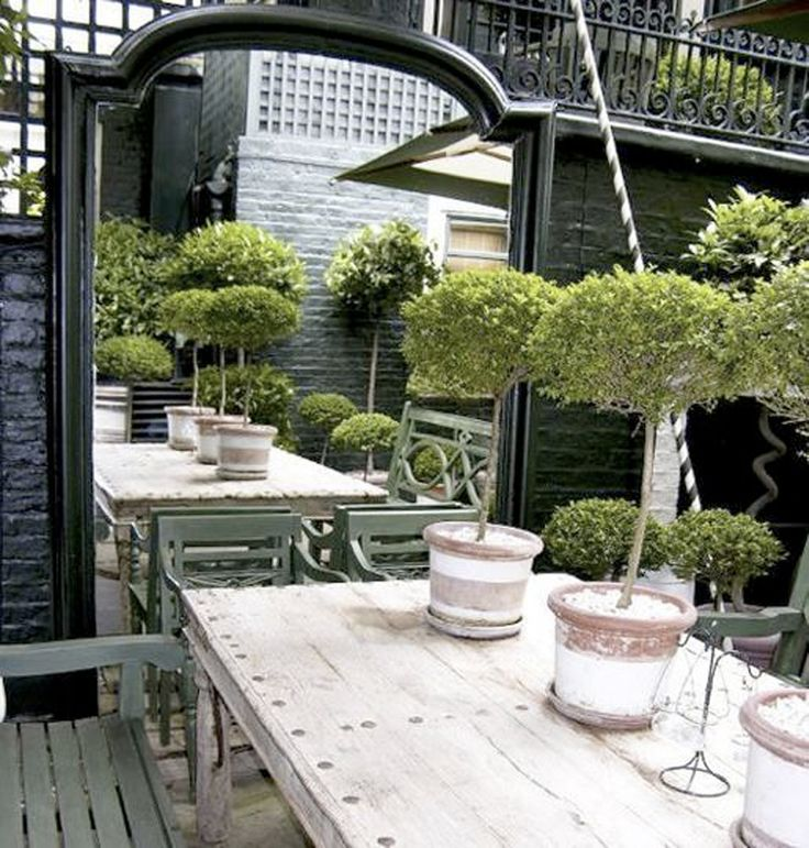 garden details. Love the table and mirror.