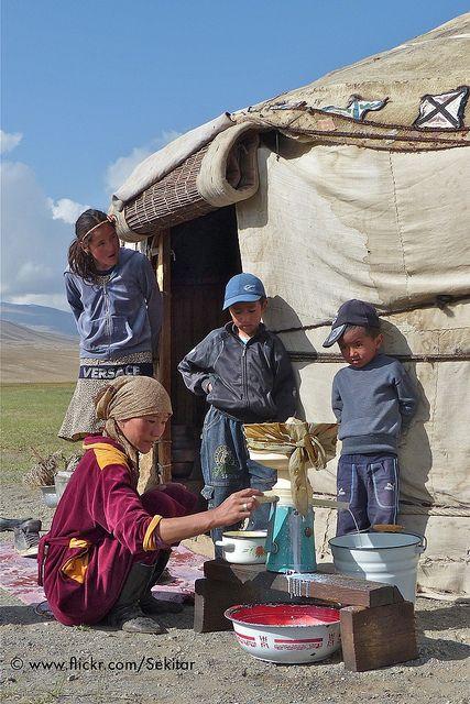Butter making around Alichur, Gorno-Badakhshan, Pamir Highway, Tajikistan. They are in front of their yurt.