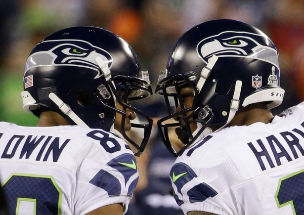 Seattle Seahawks' Doug Baldwin, left, and Percy Harvin celebrate during the first half of the NFL Super Bowl XLVIII football game against the Denver Broncos, Sunday, Feb. 2, 2014, in East Rutherford, N.J. (AP Photo/Ted S. Warren)