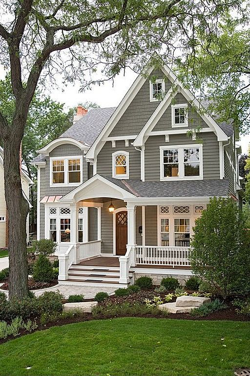 This front-gable home's wide front porch and rocking chairs speak comfort and serenity.