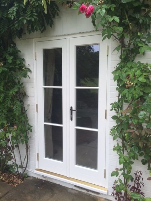 Apsley style French Doors in Farrow and Ball Colour New White. Featuring horizontal astragal bars and Windsor Bright Bronze Lever/Lever handles.