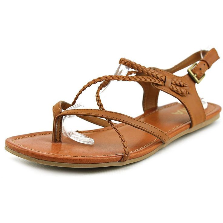 Step out in style in these Adrianna sandals, which feature a charming blend of smooth and braided straps. Made from realistic faux leather, the sandals offer a luxurious look without the added expense