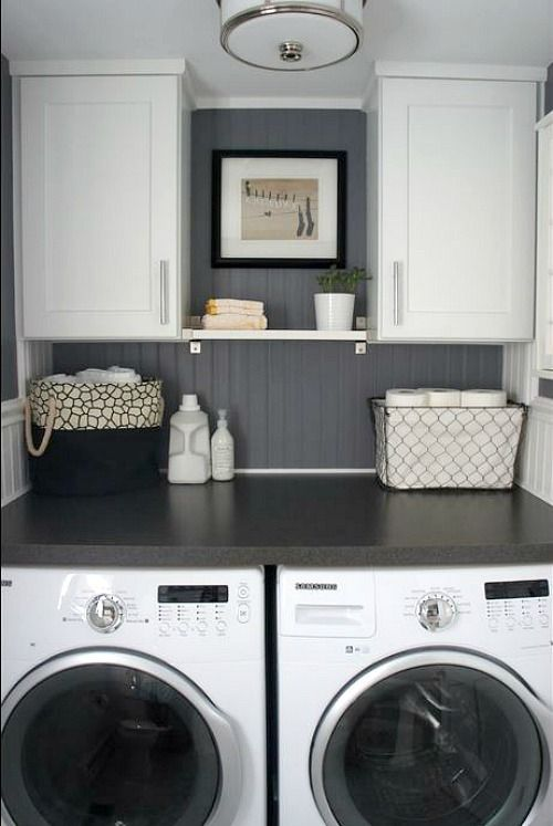 Small space laundry room - REALLY like the two cabinets with the shelf in the middle, though I think there should be two instead of just the one