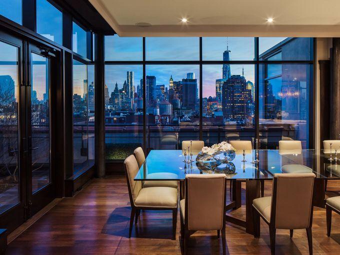 The five-bedroom penthouse has glass windows overlooking Manhattan.