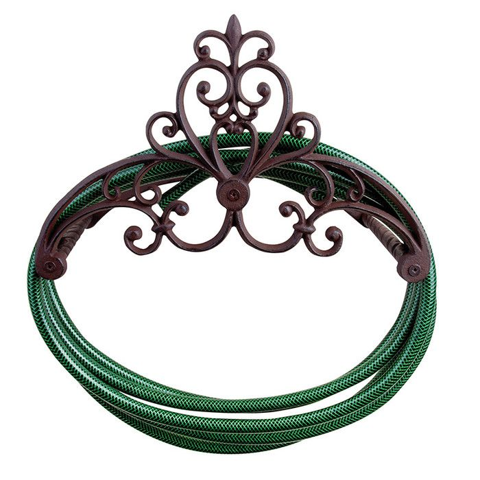 Antique Victorian cast iron large wall mounted garden hose holder. Beautifully designed scroll work accents this elegant hose holder.