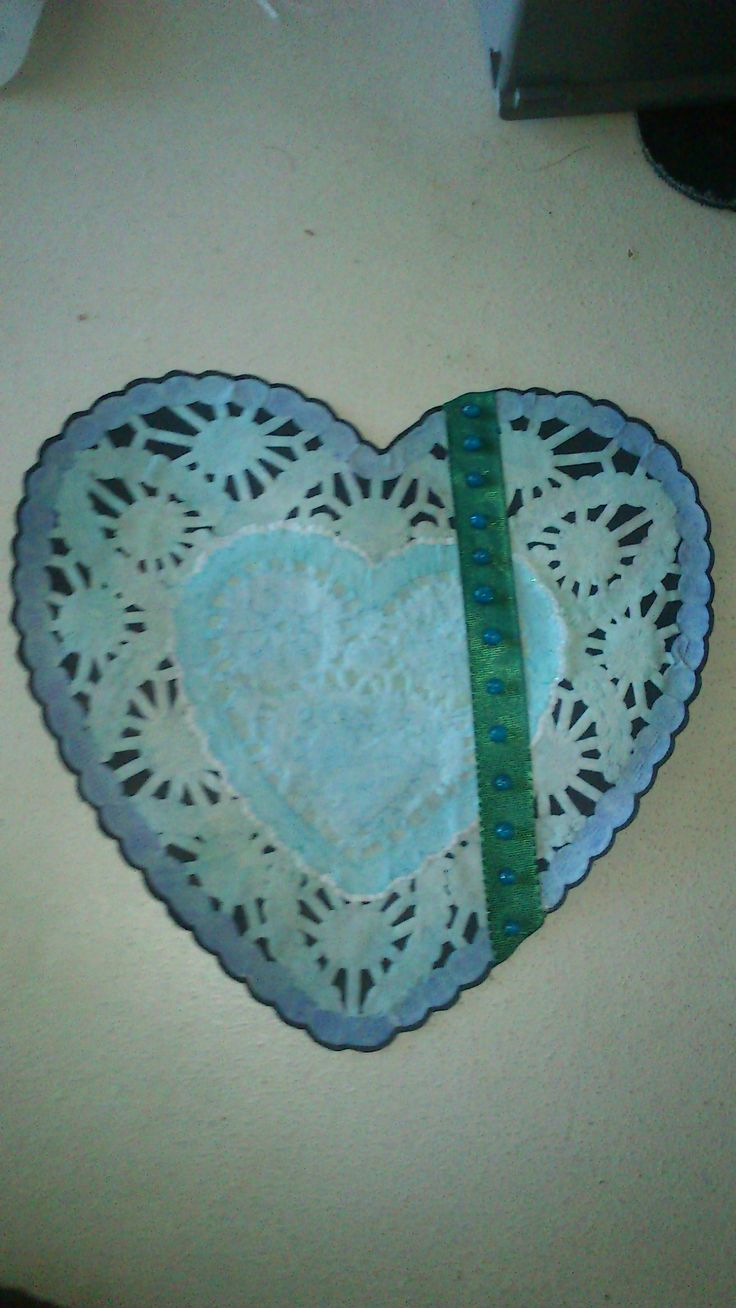 Paper Lace heart painted with water colors and decorated with a ribbon and glitter glue. -Louise Mirabilis