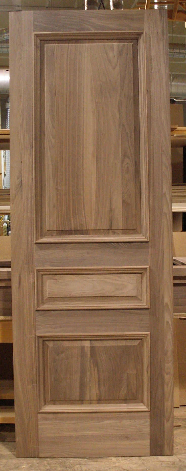 Solid Walnut door, 3 panel with raised panels and applied moulding.