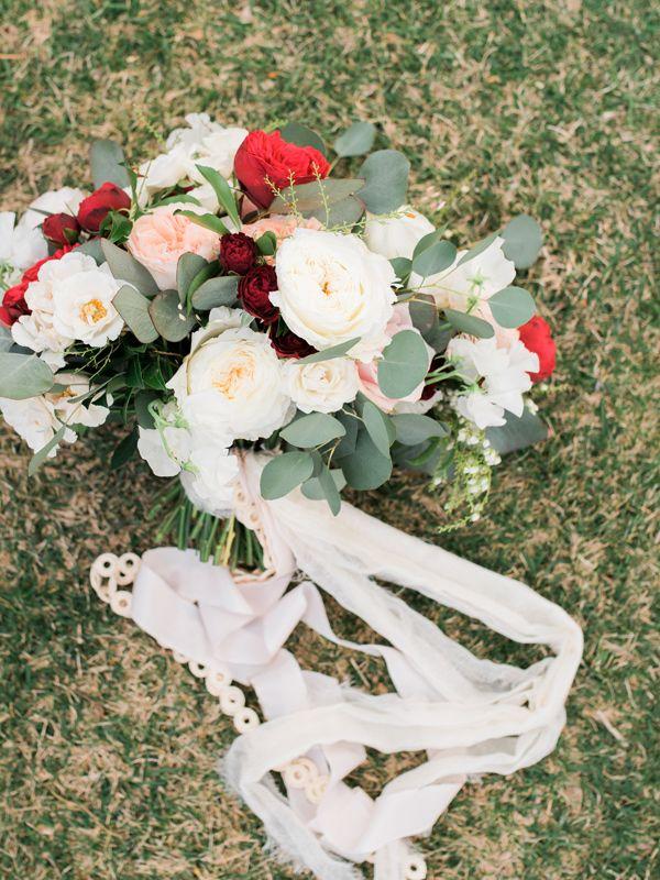 ivory bouquet with red flowers - photo by Kristen Joy Photography http://ruffledblog.com/boho-ranch-wedding-inspiration