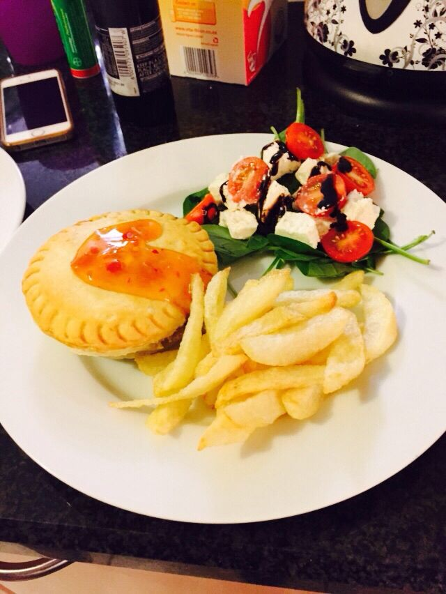 Easy chicken and mushroom pie with chips and salad.