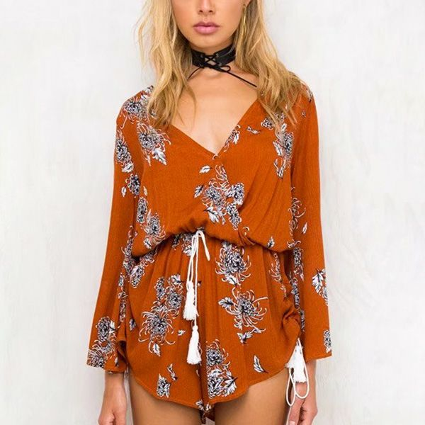 Ewa V Neck Floral Print Playsuit - The Wild Flower Shop    For the free spirited fashionista, this playsuit makes a cute outfit for summer escapades. Feminine with V neckline lends a fine aesthetics to this unique elegant look. • Front button closure • Back straps tye • Elasticated waist • Waist and side drawstring • Weight 190 gram Material: Cotton blend    $31