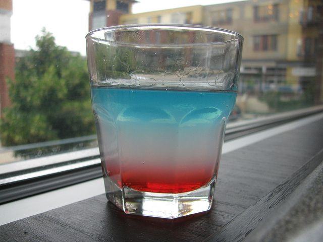 BombPop Drinks. Basically Grenadine, or Cherry Vodka, Smirnoff Ice, and Blue UV vodka. Nathaniel gave me one of these for my bday! Delish!