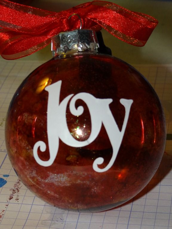 Ornament made with alcohol ink and cricut vinyl.