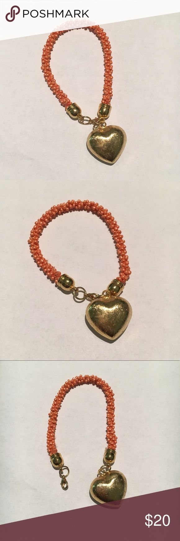 Colombian Handmade heart bracelet Handmade in Colombian. Beautiful bracelet in Coral color. Lobster claw clasp closure. New, never worn without tags. Jewelry Bracelets
