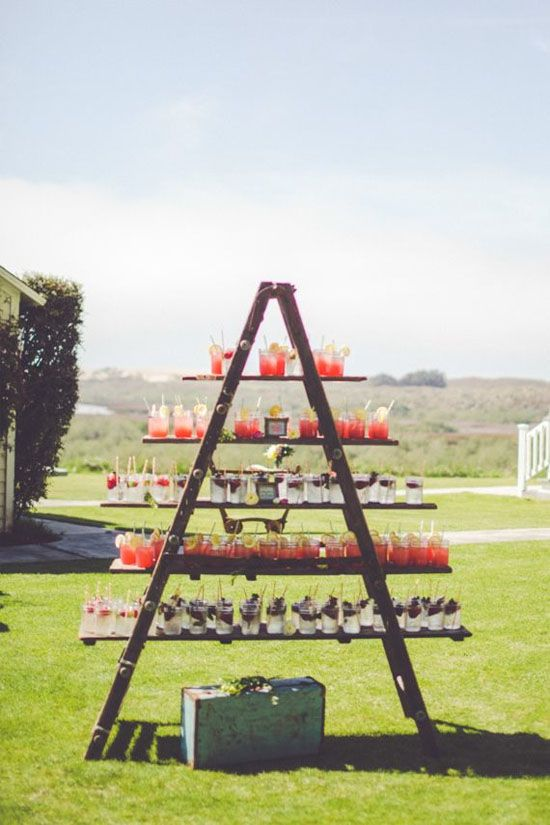 Make a drinks station for you next party by putting boards across the rungs of a ladder