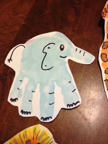 Handprint animals... we made lions, elephants and giraffes for Noah's Ark