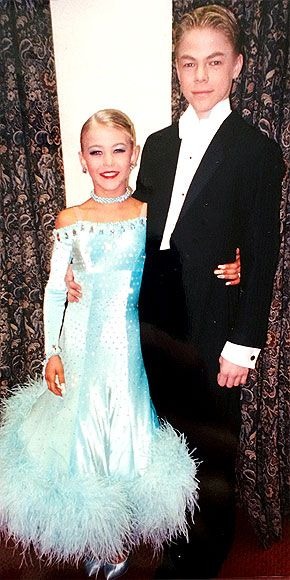 "Derek & Julianne: Growing Up Hough | BALLROOM BLITZ  | Derek, 13, and Julianne, 10 (dressed for a 1998 performance), followed a grueling schedule that started at 6:45 a.m. and included dancing, academics, and more dancing until close to midnight. ""It was hard,"" remembers Derek. ""There were moments when I just wanted to go and have fun."" Says Julianne, who wore a face full of makeup and got spray tans for competitions: ""When I look back, I think it's so sad I have no pictures of me with a ..."