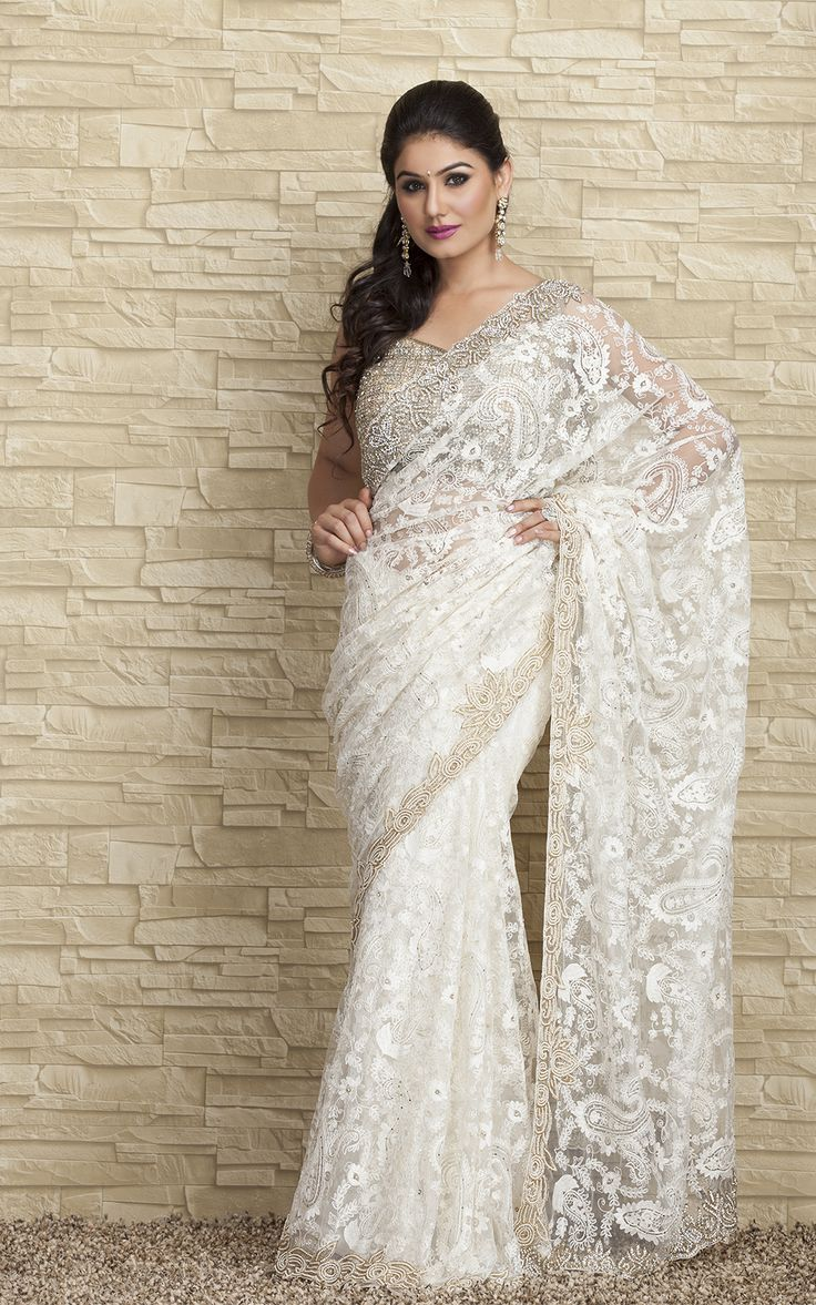 The traditional wear which symbolizes true Indian women beauty. The beautiful white saree to dress at party or outing with family. For more visit - www.snapdeal.com/products/women-apparel-sarees #saree #fashion #snapdeal #white #beauty
