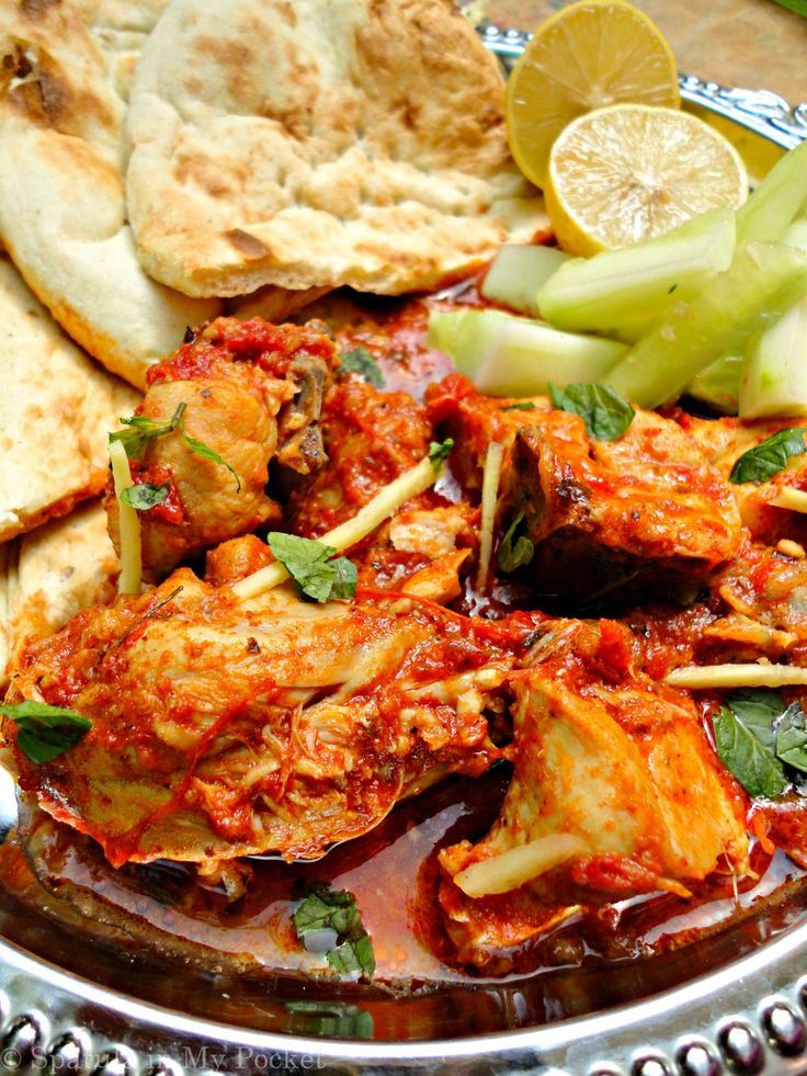 ... karhai. Tender pieces of chicken all soaked in a spicy tomato gravy
