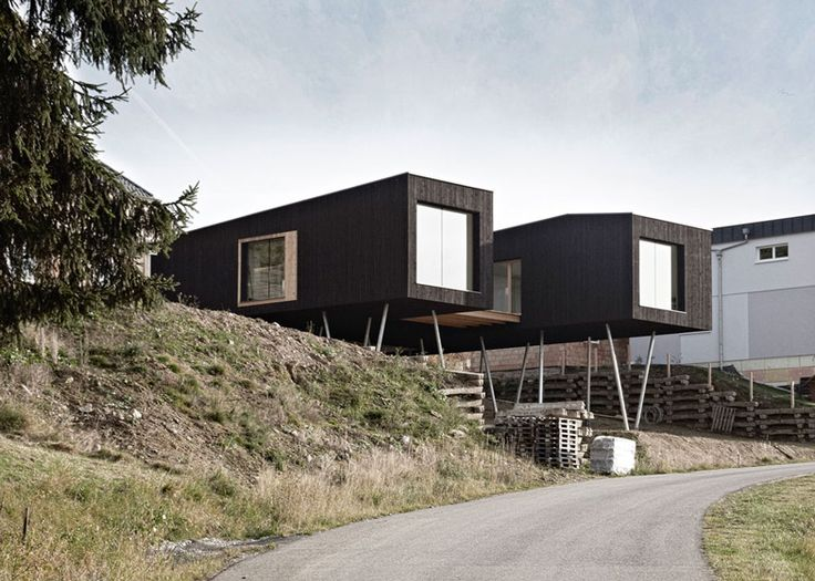 Black Painted S House By Hammerschmid Pachl Seebacher Raised On Stilts