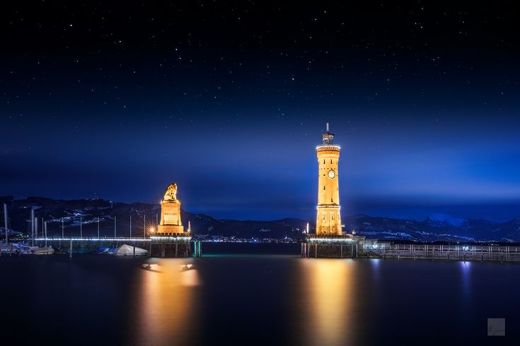 Warm Beacon - This is the New Lindau Lighthouse, the only Lighthouse in Bavaria. The picture was taken on a cold december night, but it was worth it.
