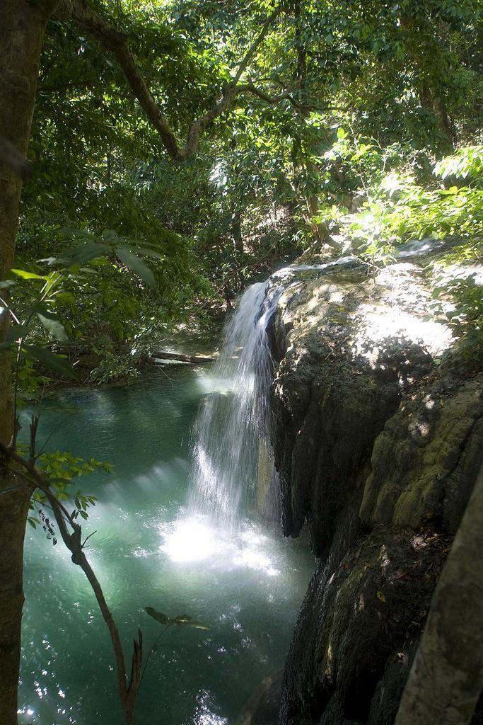 Tropical waterfall on Moyo Island. West Nusa Tenggara, Indonesia.