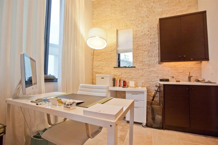 Contemporary Home Office with limestone tile floors, Built-in bookshelf, High ceiling