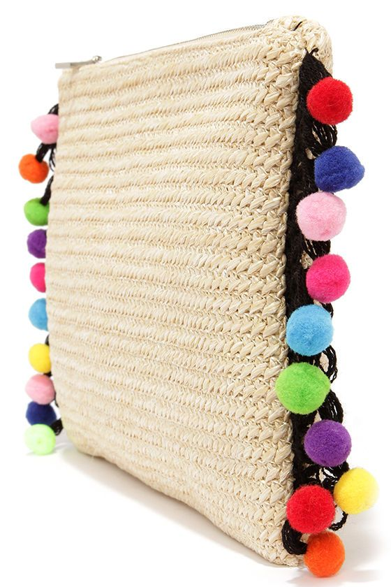 "AS SEEN IN COSMO!! We're beyond excited to announce the arrival of the totally cute Festival Frenzy Beige Pompom Clutch! This roomy rectangular clutch has a beige woven exterior with black crocheted accents and a rainbow of pompoms trimming the sides. Unzip the silver top closure to find a black and white striped fabric-lined interior with two main compartments and side wall pocket. Clutch measures 12"" wide, 8"" tall, and 2"" deep (relaxed). 100% Polypropylene. Man made materials."
