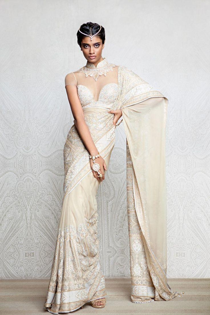 A gold shadow sari embellished with aari work Swarovski