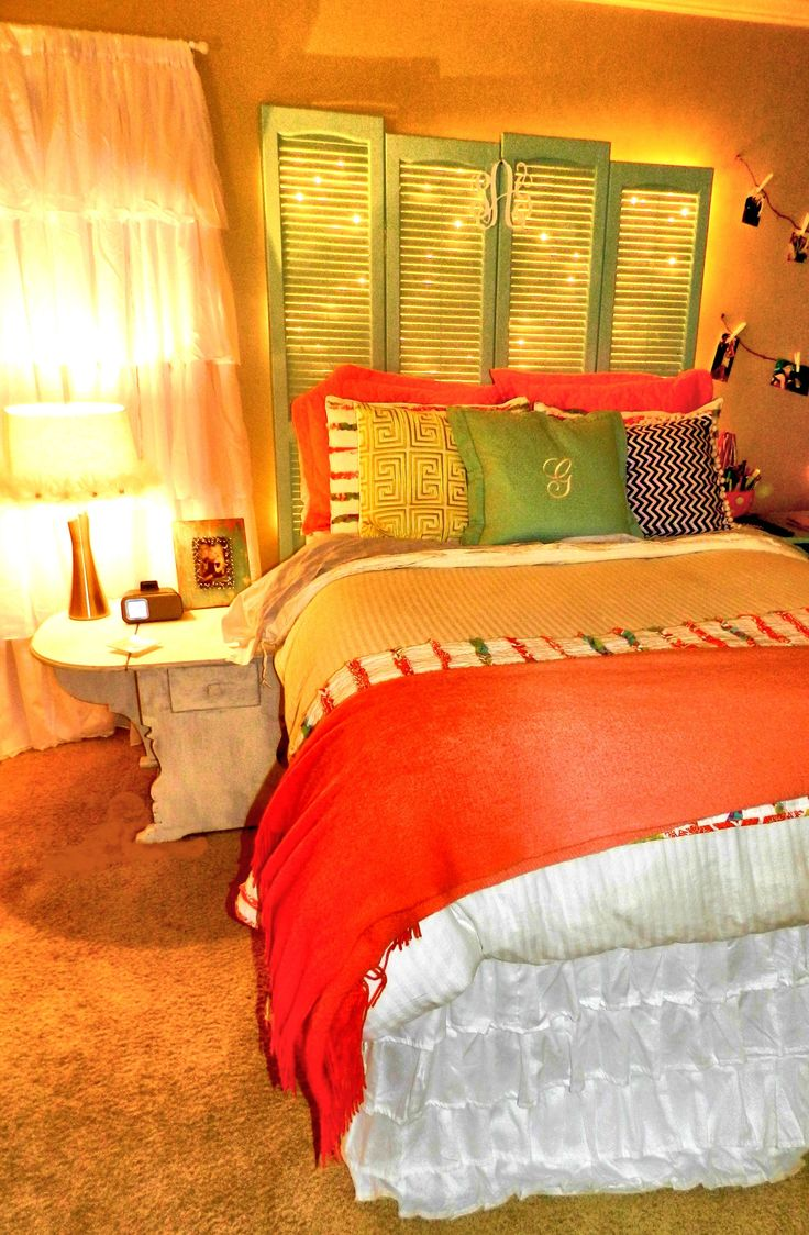 Updated picture of my apartment room. Lighted Shutter Headboard. Ruffle Curtains. DIY. Monogrammed pillow & headboard.