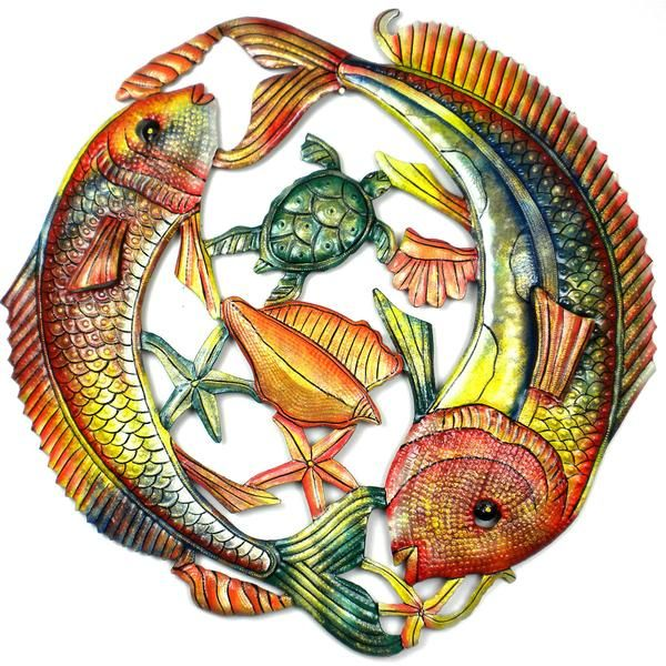 This piece of Haitian metal wall art is 24 inches in diameter. It features two large fish jumping, hand-cut, embossed and painted.