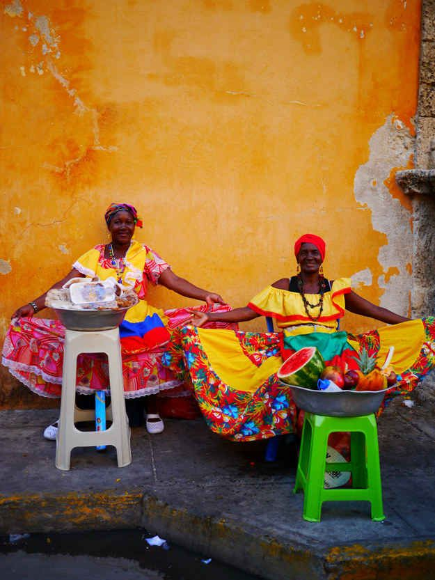 Take a break. Have some fruit from a 'Palenquera'