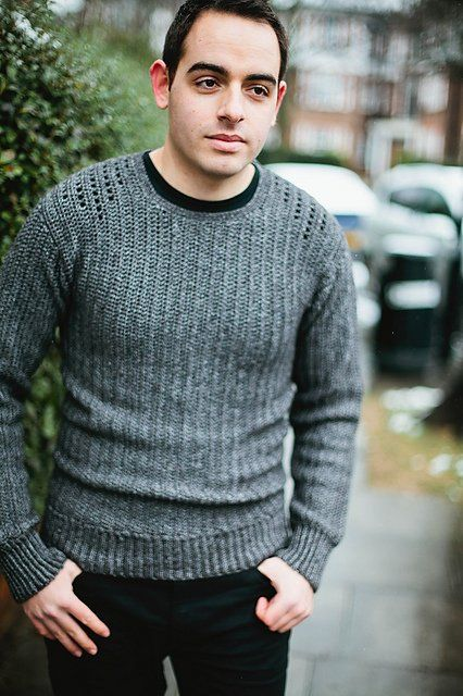 """Inside Crochet shares about this sweater pattern: """"The jumper features a masculine take on filet lace, inspired by the traditional military commando sweater."""""""