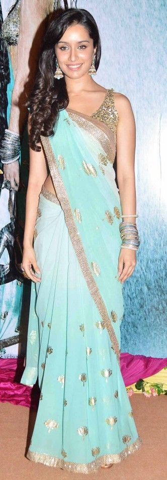 Shraddha Kapoor in aqua blue saree with gold border paired with sequin blouse