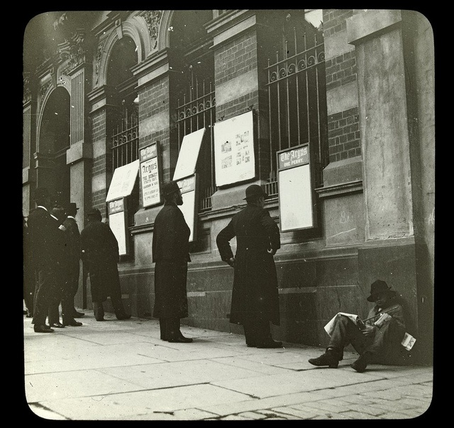 Reading outside The Argus office in Collins Street, Melbourne c. 1894.